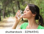 young woman drinking with water ... | Shutterstock . vector #32964541
