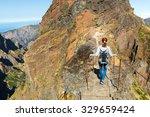traveler hiking in mountains ... | Shutterstock . vector #329659424