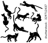 Stock vector set of eight black vector silhouettes of funny domestic cats in different poses on a white 329712437