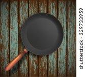 steel pan stands on a wooden... | Shutterstock .eps vector #329733959