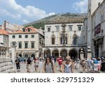 "Small photo of DUBROVNIK, CROATIA - AUGUST 13, 2015: The Sponza Palace, also called Divona, is a 16th-century palace. Its name is derived from the Latin word ""spongia"", the spot where rainwater was collected."