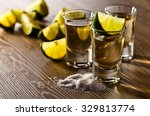Stock photo tequila with salt and lime on old wooden table 329813774
