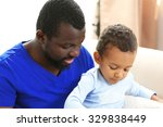 father and son on sofa in the... | Shutterstock . vector #329838449
