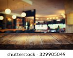 image of wooden table in front... | Shutterstock . vector #329905049