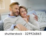 mature couple relaxing in couch ... | Shutterstock . vector #329926865