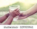 woman hand giving glass of... | Shutterstock . vector #329935961