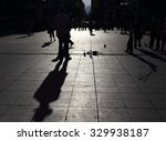 shadows of people walking in a... | Shutterstock . vector #329938187