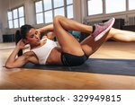 young fit woman exercising in a ... | Shutterstock . vector #329949815