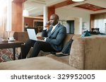 businessman sitting on sofa... | Shutterstock . vector #329952005