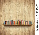 bookshelf on yellow wooden wall | Shutterstock . vector #329955809