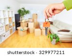 hand with house key. real... | Shutterstock . vector #329977211