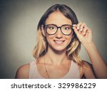 closeup young woman in glasses | Shutterstock . vector #329986229