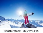 back view of female snowboarder ... | Shutterstock . vector #329998145