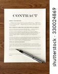 Small photo of Legal Contract/Agreement with Fountain Pen