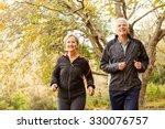 senior couple in the park on an ...   Shutterstock . vector #330076757