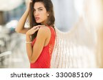 young woman in the red dress | Shutterstock . vector #330085109