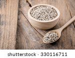 pepper in a bowl on wooden... | Shutterstock . vector #330116711