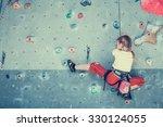 Little Girl Climbing A Rock...