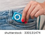 blue mp3 player isolated on jean