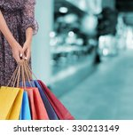 female hand with shopping paper