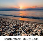 Stones On Beach And Sea Water