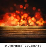 Christmas holiday background with empty wooden deck table over Christmas tree. Empty display for montage. Rustic vintage Xmas background. - stock photo