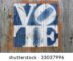 faded colors vote sign on a weathered gray plywood - stock photo