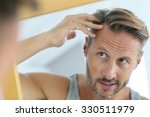 middle aged man concerned by...   Shutterstock . vector #330511979