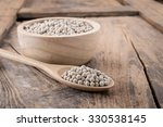 pepper in a bowl on wooden... | Shutterstock . vector #330538145