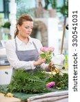 florist making rose bouquet at... | Shutterstock . vector #330541031