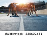 sprinters at starting blocks... | Shutterstock . vector #330602651
