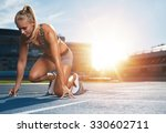 young woman athlete at starting ... | Shutterstock . vector #330602711