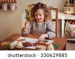 Cute Child Girl Making...