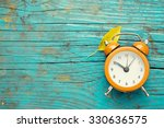clock in nature | Shutterstock . vector #330636575