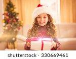 Festive Little Girl Opening A...