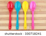 colourful spoon on wooden | Shutterstock . vector #330718241