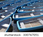 group of blue rowboat at river | Shutterstock . vector #330767051