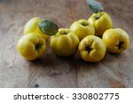 Quince On Wooden Table