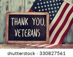 Stock photo the text thank you veterans written in a chalkboard and a flag of the united states on a rustic 330827561