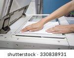 woman hands putting a sheet of... | Shutterstock . vector #330838931