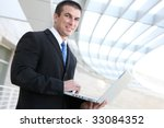 happy young business man using...   Shutterstock . vector #33084352
