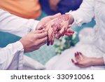 Malay Wedding Couple Putting A...