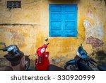 row of motorbikes parked near... | Shutterstock . vector #330920999