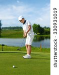 boy playing golf and hitting by ... | Shutterstock . vector #330931019