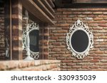 the mirror in a white frame on... | Shutterstock . vector #330935039