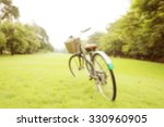 bicycle on the green grass at... | Shutterstock . vector #330960905