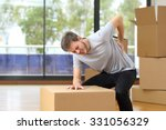 man suffering back ache moving... | Shutterstock . vector #331056329