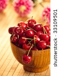 cherries in bowl with shallow depth of field - stock photo
