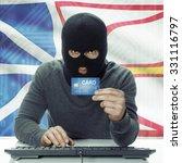 dark skinned hacker holding... | Shutterstock . vector #331116797