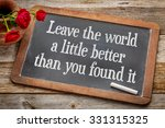 Small photo of Leave the world a little better than you found it - life purpose and meaning concept - white chalk text on a vintage slate blackboard with red roses against rustic wood